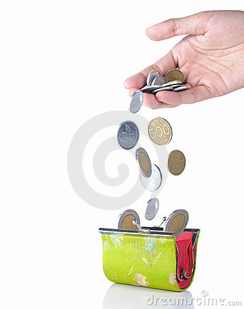 Hand put coin into the wallet