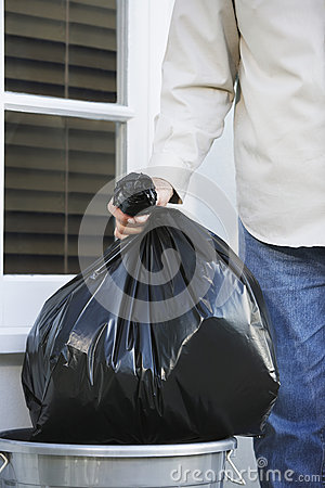 Free Hand Putting Garbage Bag Into Trash Can Stock Photography - 33890002