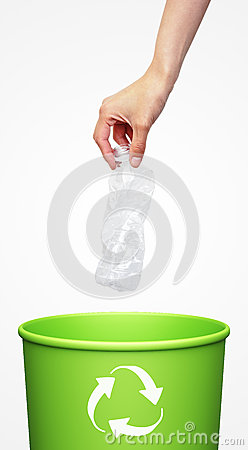 Hand putting a plastic bottle