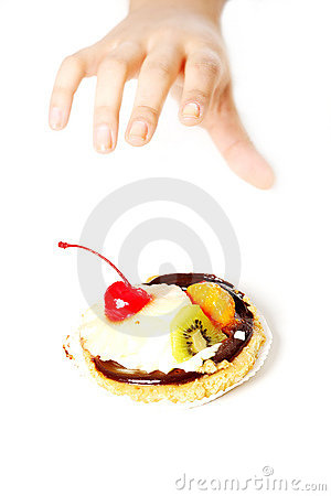 Free Hand Reaching For A Cake. Royalty Free Stock Photo - 21585855