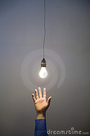 Hand reaching for light bulb