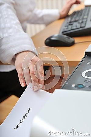 Hand reaching resignation letter