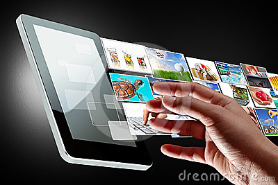 Hand reaching streaming multimedia of the tablet