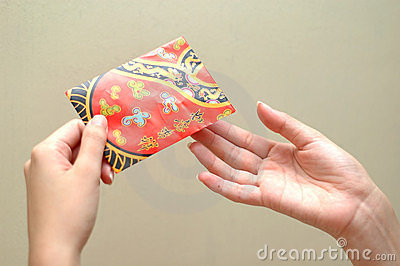 Hand and red packet