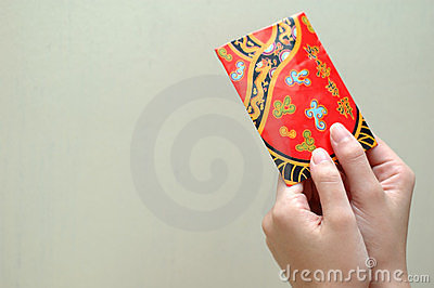 Hand with red packet