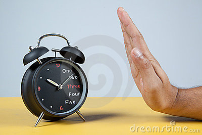 Hand resisting a clock