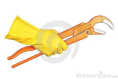 Hand in rubber glove clasps a pipe wrench