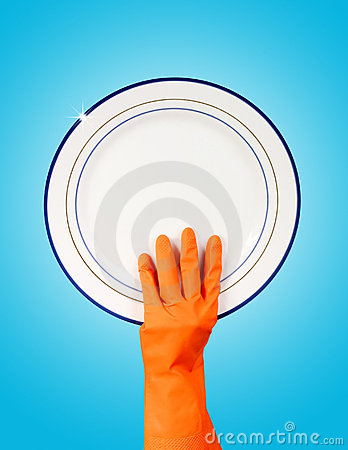 Hand in rubber glove holding clean plate