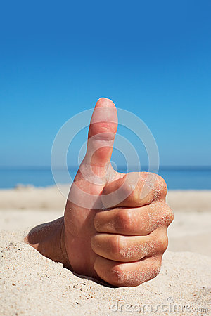 Hand and sand.