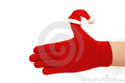 Hand with  santa hat. Isolated on white.