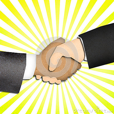 Hand shake, business deal with yellow ray