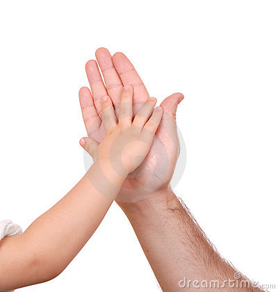 Hand shake of the child and father