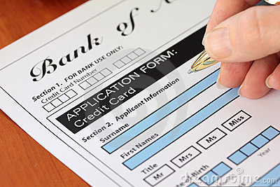 Hand Signing a Fictitious Credit Card Application