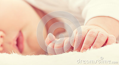 Hand of sleeping baby newborn close up