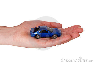 hand with small car