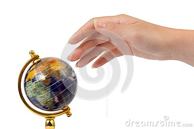 Hand and spinning globe