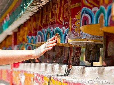 Hand spinning the prayer wheels