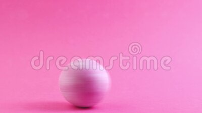 A hand spins a painted pink egg on a pink background. Easter egg rotation. Easter. Video clip. HD. A hand spins a painted pink egg on a pink background. Easter stock video