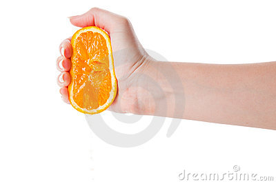 Hand squeezing an half of orange