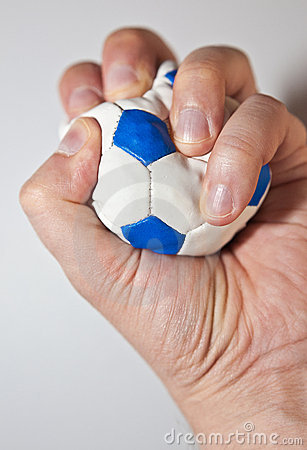 Hand squeezing the stress ball