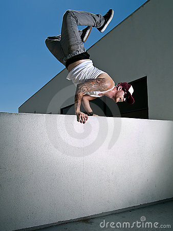 Hand stand over a wall