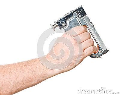 Hand with staple gun