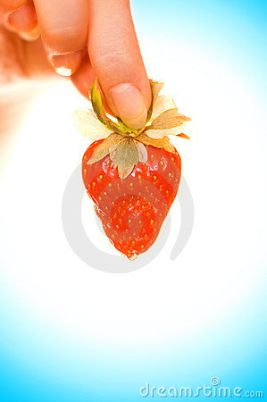 Hand with a strawberry