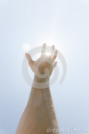 Hand stretched as a religious gesture