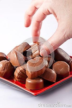 Hand taking chocolate