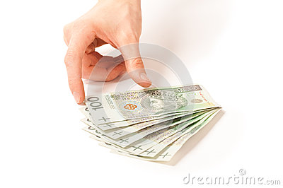 Hand taking paper money to use in business