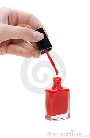 Hand with tassel and red varnish for nail