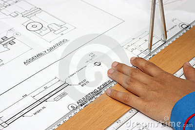 Hand with technical drawing