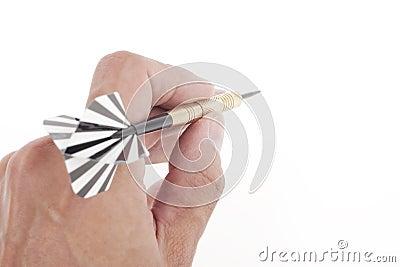 Hand throwing dart to target