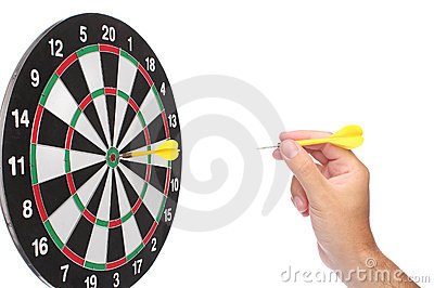 Hand throwing a yellow dart