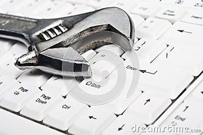 Hand tool on keyboard