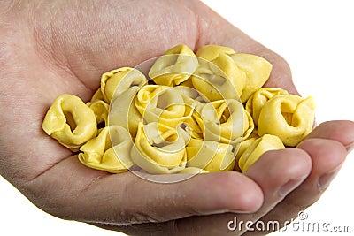 Hand with tortellini