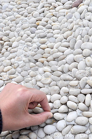 hand touch pebbly path