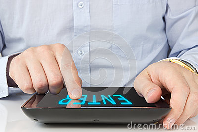 Hand touching screen on digital tablet pc