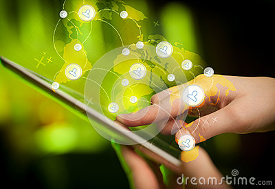 Hand touching tablet pc, social network concept Stock Photo