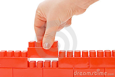 Hand with the toy block isolated