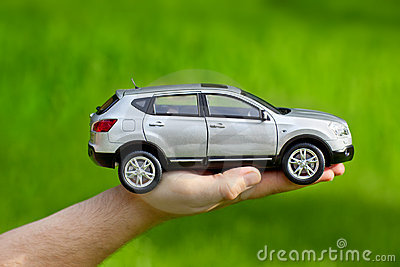 Hand with toy car