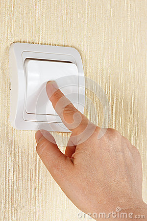Free Hand Turn Off The Light Switch On The Wall Royalty Free Stock Photo - 30692045