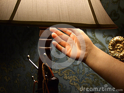 Hand turning off light