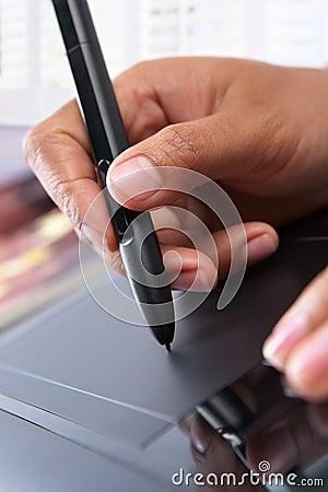 Hand using digital pen tablet