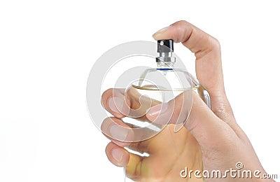 Hand using perfume