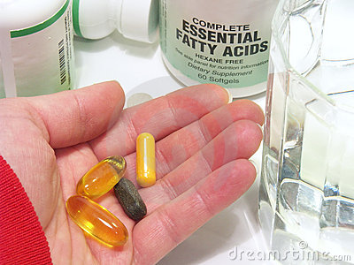 Hand with Vitamins