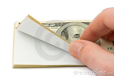 Hand and wad of paper