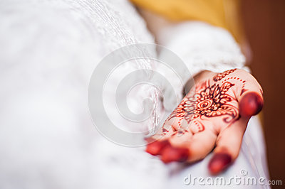 Hand wearing Henna