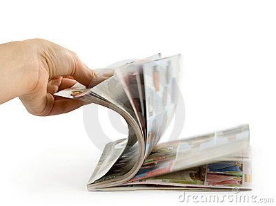 Hand which is thumbing magazine