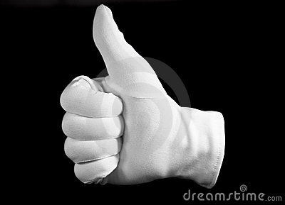 Hand in a white cotton glove gesturing a thumbs up